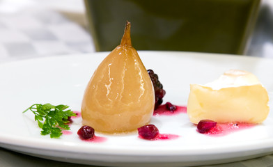 Glazed pear with cheese and berries and sauce