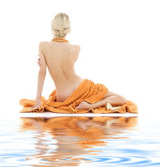 beautiful lady with orange towels on white sand