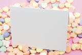 Blank card on a candy heart background