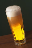 Freshly Poured Beer with Overflowing Foam in a Tall Glass poster