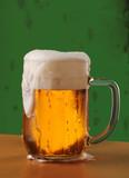 Mug of Freshly Poured Beer with Overflowing Foam Head poster