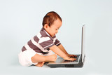A happy toddler learn how to use a laptop computer poster