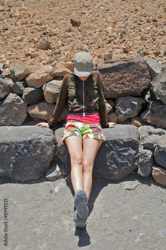 woman sitting on stone