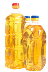 Three bottles filled with sunflower oil. Two high and one low.