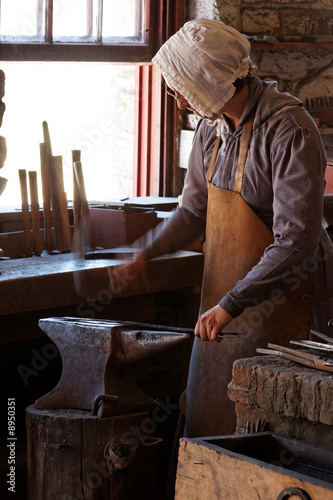 Woman Blacksmithing