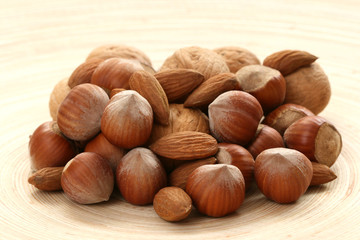 close-ups of hazelnuts and walnuts on wooden table