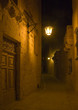 A lantern lit alley by night in Malta