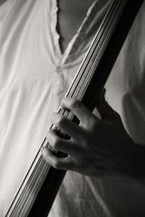 male hand of a neck of electric upright bass,