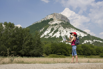 woman with the binoculars in the mountains