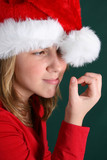 Teenager in red shirt and fluffy christmas hat poster