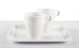 White cups on white plate poster