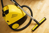 vacuum cleaner on a wooden floor poster