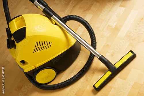 poster of vacuum cleaner on a wooden floor