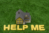 House with the words help me on grass. mortgage crisis poster