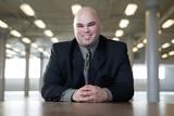 Portrait of a business man smiling.