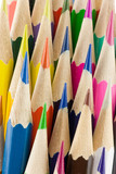 Stack of colored hexagon shaped pencils macro, selective focus poster