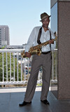 Handsome Black Saxophone Player in Casual Business Attire poster