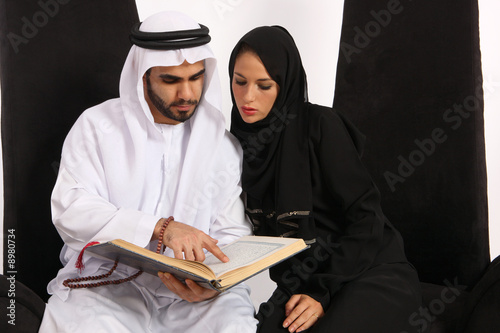 Arab Man Reads & Explains Verses From The Quran To His Wife
