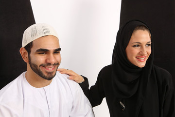 Happy Arab Couple Having A Good Time Watching A Play