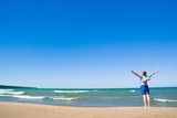 Man with  arms outstretched standing on the lakeshore poster
