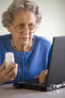 Senior woman researching prescription  on-line