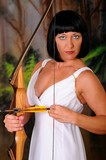 Girl dressed like a Greek Goddess holding a bow and arrow poster