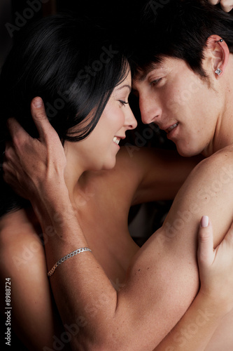 Young adult Caucasian couple in passionate embrace
