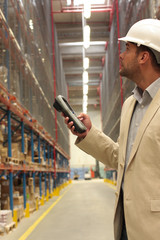An inspector with bar code reader in a factory