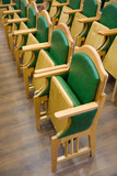 wood folding chairs rows on a parquet floor poster