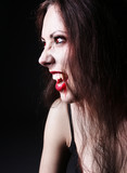 portraite sexy vampire-girl on black background poster