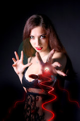 mystirious sexy girl vith electricity in her hand