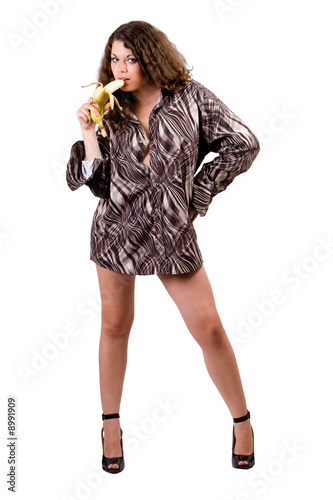 young sexy beauty woman in a man's shirt with a banana. Isolated
