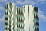 Urban Condominium on a cloudy sky poster