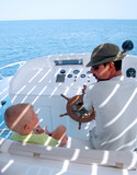 little boy and captain on the boat poster