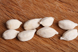 eight white cardamom pods on old wood poster