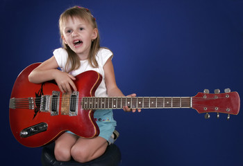 little girl with electric guitar