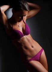 sporty looking woman posing in lingerie