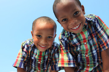 Two boys looking down at the camera