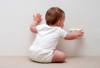 Baby touching power socket