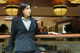 Businesswoman in a business complex poster