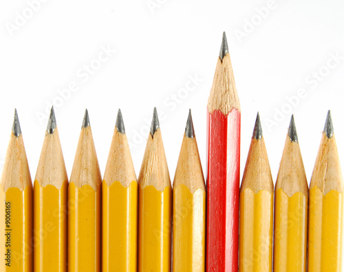Some yellow pencils and one red on the white background