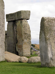 Cars viewed through Stonehenge