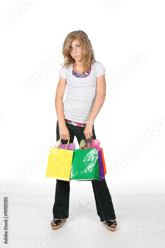 girl with many bags from school shopping