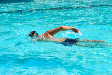 Swimming young man (the crawl)