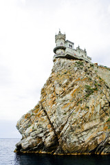 The castle in the Gothic style on cliff above the sea