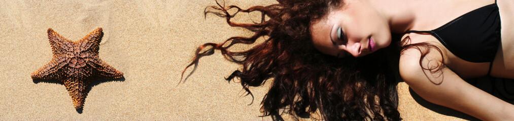 a girl taking a sunbath lying on the sand