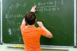 Schoolgirl at the blackboard. Lesson of mathematics. poster