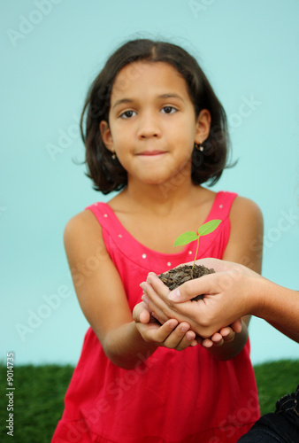 Woman Holding A New Plant In Dirt