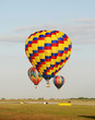 Colorful hot air balloons floating and landing
