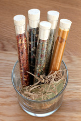 spices in a glass on wood table